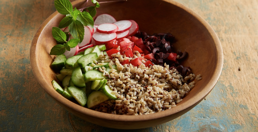 Whole Grain Greek Salad with Cucumber Radish and Mint step in bowl